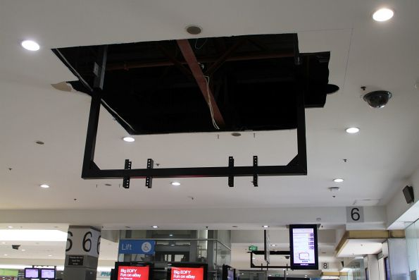 Steel brackets attached to the concourse roof