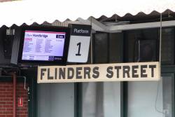 New platform number signage bolted to the PIDS at Flinders Street Station