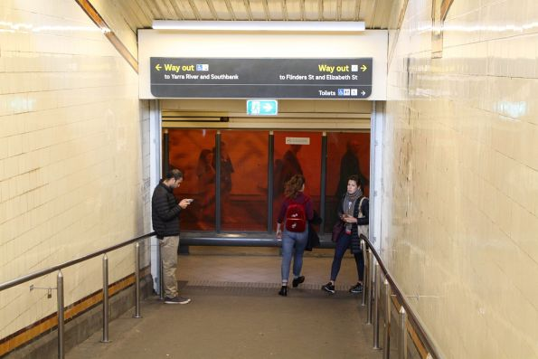 New directional signage at the bottom of the Elizabeth Street subway ramps