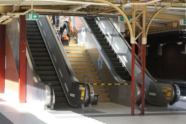Repainting the stair treads at Flinders Street platform 6 and 7