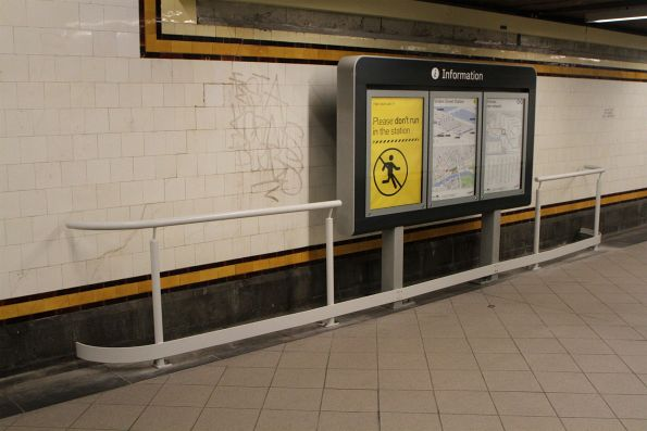 Metal handrails prevent the vision impaired from crashing into signage in the Centre Subway