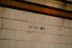 'Do not spit' tiles in the Elizabeth Street subway