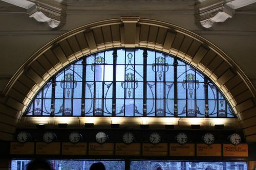 Four panes of plain glass have replaced the original leadlight panels