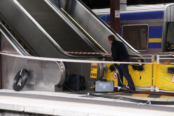 Feeding through a new escalator handrail