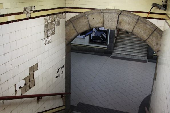 Missing tiles and exposed electrical cables: Centre Subway to platform 4/5