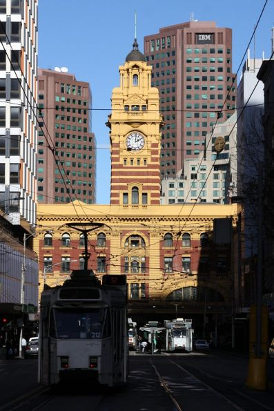 Z class trams shunt on Elizabeth Street, Flinders Street Station clocktower at the far end
