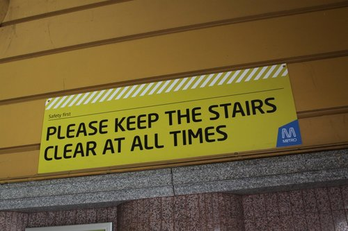 'Please keep the stairs clear' sign hidden on a wall beneath the main dome