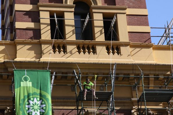 Sitting on scaffolding above Flinders Street doesn't look very safe to me...