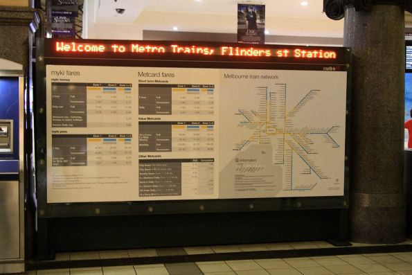 Information board for tourists outside the paid area at Flinders Street Station