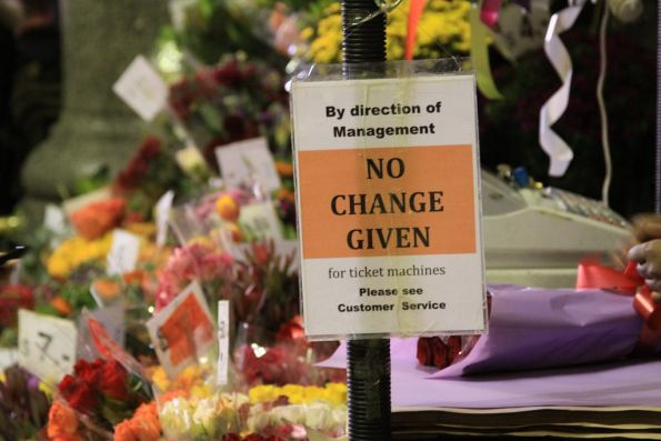 'No change given for ticket machines' sign at the florist under the Flinders Street Station clocks