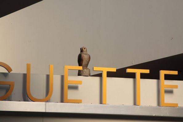 Fake owl atop one of the food kiosks on the main concourse