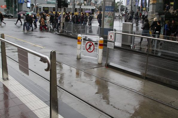Three layers of fences installed to control pedestrians at the corner of Flinders and Swanston Street