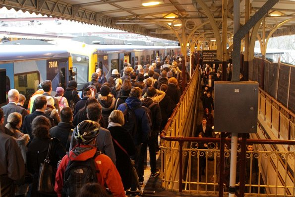 Congestion at the west end of platform 10, with passengers having to squeeze through a single narrow walkway to exit