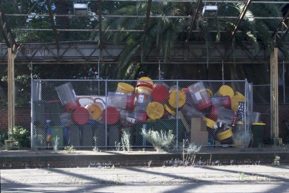 Now redundant rubbish bins stored in the 'Milk Dock' at Flinders Street