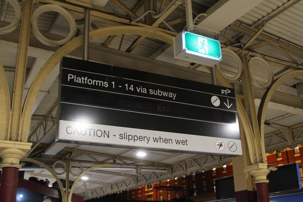 Illuminated 'Degraves/Flinders Street Exit via subway' sign switched off at Flinders Street platform 6 and 7