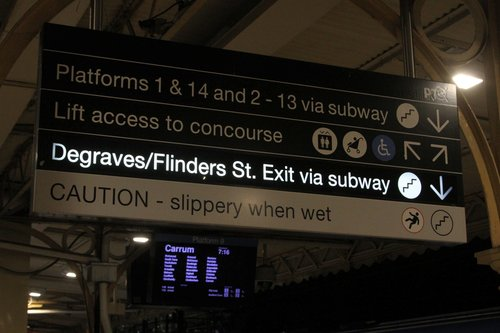 Illuminated 'Degraves/Flinders Street Exit via subway' sign switched on at platform 8 and 9