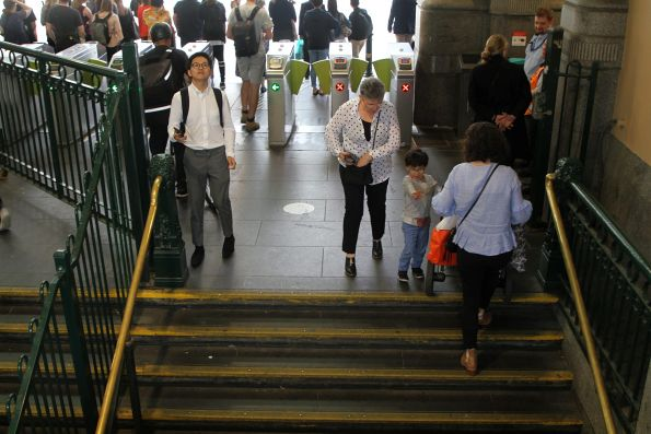 Carrying a pusher down the stairs at the Elizabeth Street end of the station