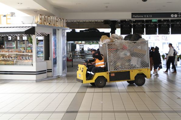 Electric buggy loaded with rubbish on the main Flinders Street Station concourse