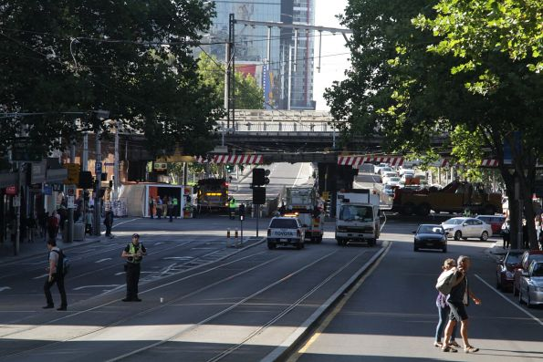 Flipped truck under the Flinders Street Viaduct