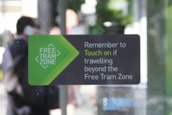 'Remember to Touch on if travelling beyond the Free Tram Zone' on a tram stop