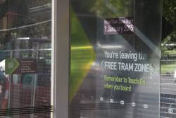 'You're leaving the Free Tram Zone' notice on a tram stop at Victoria Parade and Nicholson Street