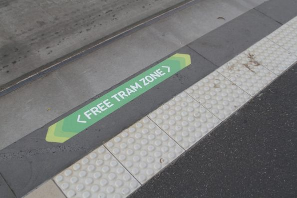 'Free Tram Zone' signage on the edge of a platform tram stop