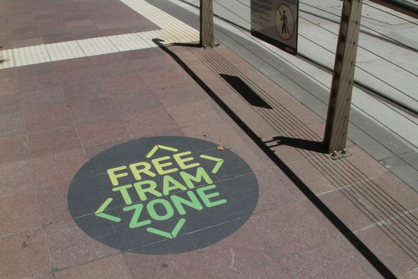 'Free Tram Zone' signage at the entrance to a platform tram stop