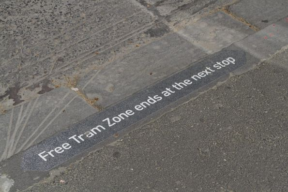 'Free Tram Zone ends at the next stop' notice at a ground level tram stop