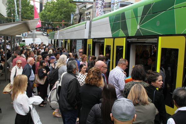 Massive crowd of passengers trying to board a westbound tram in the Bourke Street Mall