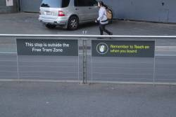 'This stop is outside the Free Tram Zone' signs at the Casino East stop on Queensbridge Street