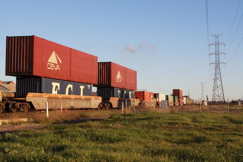 53 foot containers stacked atop 40 foot containers in well wagons