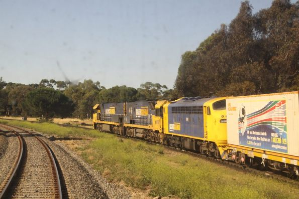 NR8 and NR108 with banker S307 wait for a path across Torrens Junction on their eastward journey to Melbourne