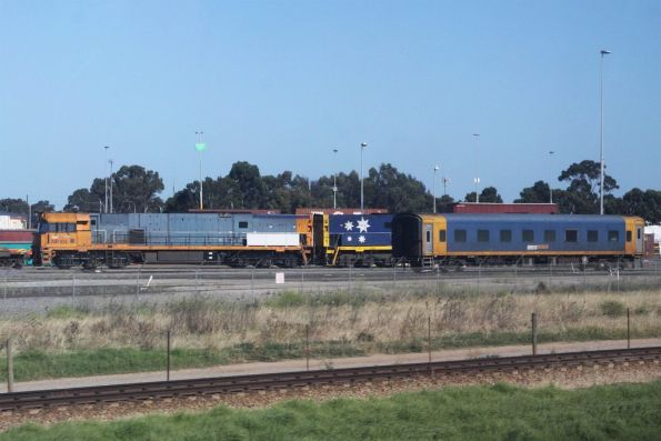 NR104 and classmate stabled at the Adelaide Freight Terminal, beside a ex-BS carriage crew car