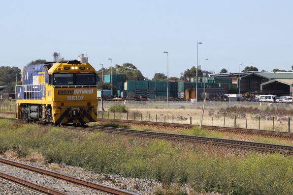 NR107 heads light engine past the Adelaide Freight Terminal, bound for Dry Creek