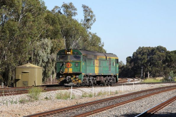Blocking trains for Outer Harbor for a minute to two, 701 passes the grade crossing at Torrens Junction