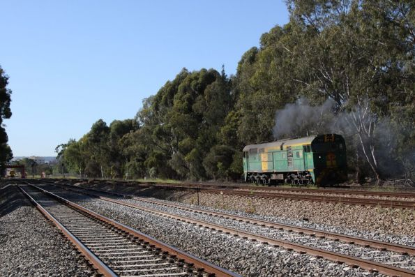 With a bit of Alco smoke out of the exhaust, 701 departs Torrens Junction for Keswick