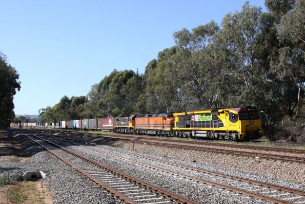 With the signal cleared, QRN's 6009, CLP10 and X53 depart Torrens Junction
