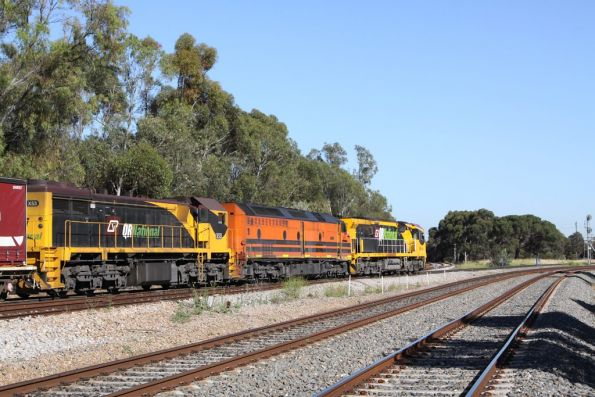 No trains to Outer Harbor for a few minutes, as the QRN freight rolls over the grade crossing at Torrens Junction