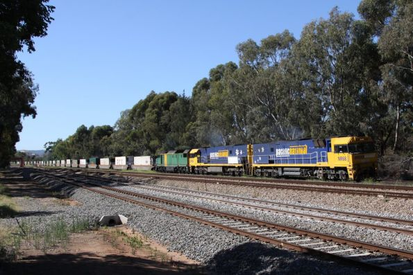 With the signal cleared at Torrens Junction; NR68, NR56 and DL48 power towards the grade crossing