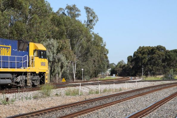 NR68 approaches the grade crossing with the Outer Harbor line at Torrens Junction