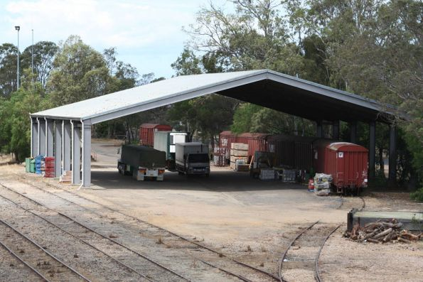 Large sized girder framed shed at Bairnsdale, VBCW vans used by a contractor for storage underneath