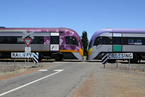 VLocity VL20 and VL04 cross an unprotected level crossing outside Meredith