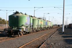 A motley crew of cement, grain and flat wagons awaiting departure from North Geelong Yard