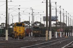 The usual yard shunter H1 stabled at North Geelong, in the background T and X class stabled push-pull on empty log wagons for an Endeavour railcar transfer