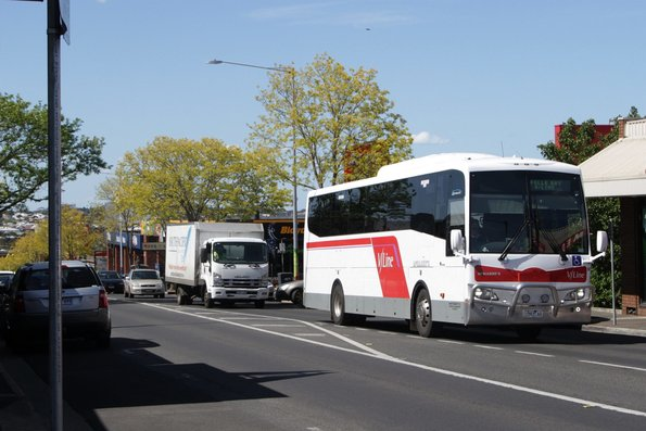 McHarry's 1593AO on the V/Line Apollo Bay service heads south on High Street, Belmont