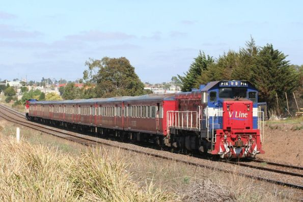 P14 leads an 8-car long push-pull football special at North Geelong