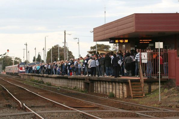 Geelong cats fans waiting for the footy special at South Geelong
