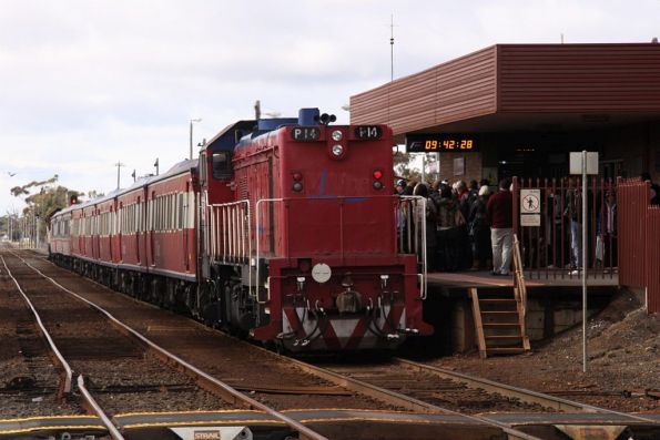 P14 on the other end of the consist, passengers wait to board