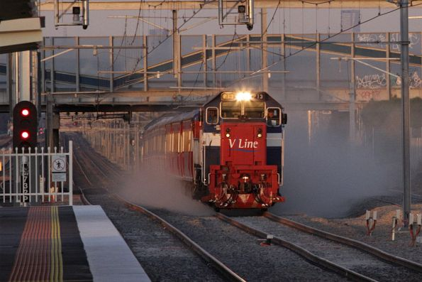 P13 leads a second push-pull football special through Laverton, kicking up the dust on relaid track