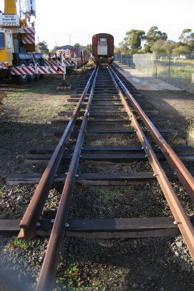 What appears to be triple gauge track on a siding not connected to the main line
